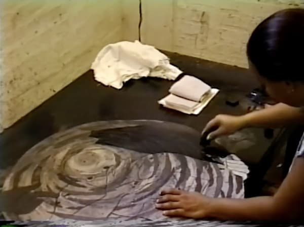 """Belkis Ayón Manso printing the artwork """"Acoso"""" in 1998."""
