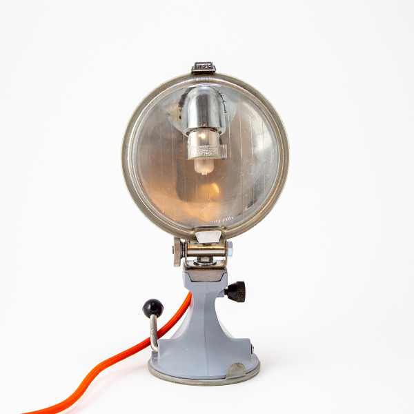 Upcycled vintage Ford Escort headlight on mid century kitchen appliance base