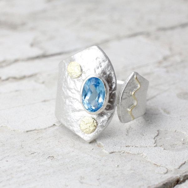 Marsha Drew, Textured Split Ring, Oval Swiss Blue Topaz with 18k Gold Detail