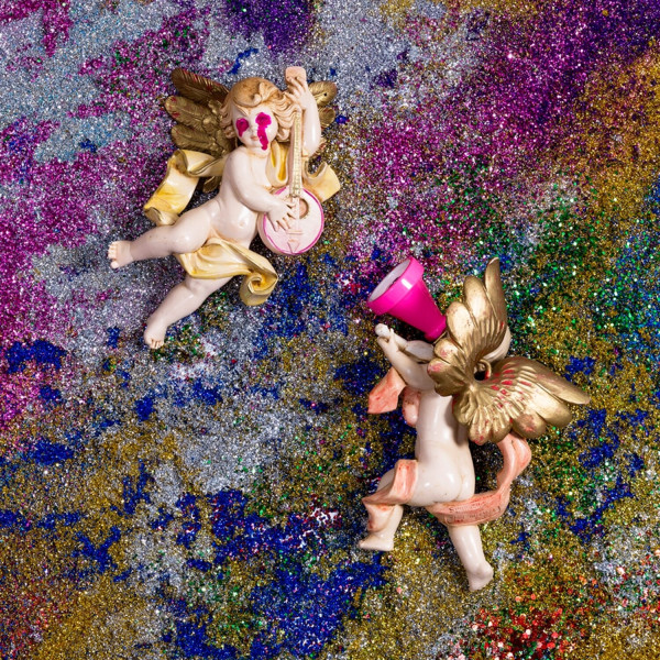 """La Creacion Discrimina,"" inkjet print. Wannam's painterly use of glitter is reminiscent of fleeting sand paintings, despite appearances of an imposed, fixed narrative in the statuettes"