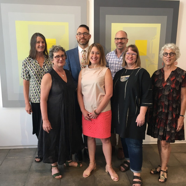 Clockwise from top-left: Nancy Johnson, Graphic Designer; Wilder Schmaltz, Associate Director; Charles Froelick, Owner; Mariel Pitti, Assistant Director; Laury Emerson, Business Manager; Rebecca Rockom, Director; Stacey Fletcher, Business Manager.