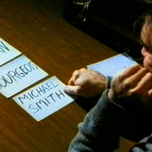 Film still of Michael Smith, How to Curate Your Own Group Exhibition (Do It), 1996, 2:55 min, video