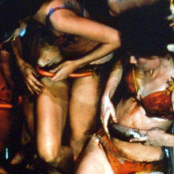 Performance still of Carolee Schneemann, Meat Joy, 1964, Eight cast members, including the artist, covered in paint with paper, plastic, rope, and paint brushes activating flesh as material with raw fish, meat, and poultry, Performed at the Festival de la