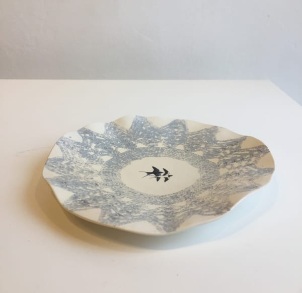 White Plate with Blue Star-shaped Lace Pattern