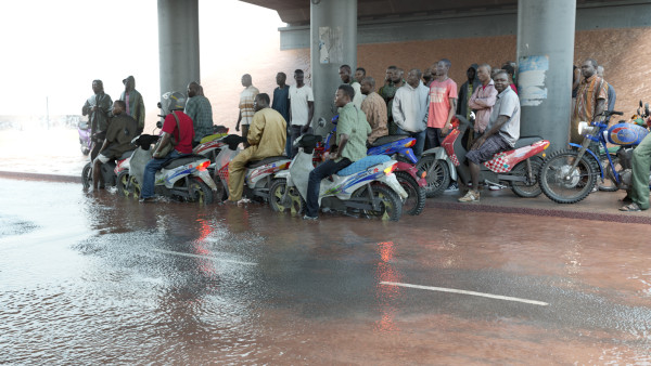 <span class=%22title%22>Oil workers (from the Shell company of Nigeria) returning home from work, caught in torrential rain<span class=%22title_comma%22>, </span></span><span class=%22year%22>2013</span>