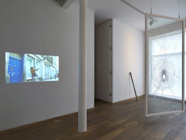 Brick 2009 broken window, scaffold pole, correspondence (12 parts), projection