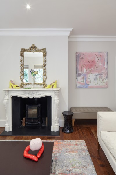 Sandra Lane (shoe sculptures on mantlepiece), Lindsey Mendick (vase and flowers on mantlepiece), Penny Goring (sculpture on coffee table) and Thomas Langley (painting on right)