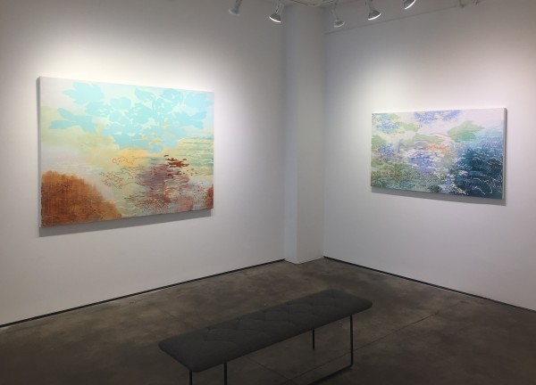 Installation shot of two different paintings by Laura Fayer. The paintings are