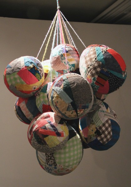 Eliza Fernand  Remnant Balloon Balls, 2011  reclaimed fabrics, paper, paste, yarn  40 x 30 x 30 in.