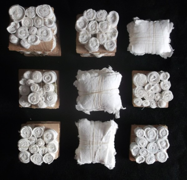 """Sarah Irvin, """"Quilling V""""  2012  Cotton quilting thread, salvaged wood, handmade cotton paper  7.5 x 7.5 x 2 in."""