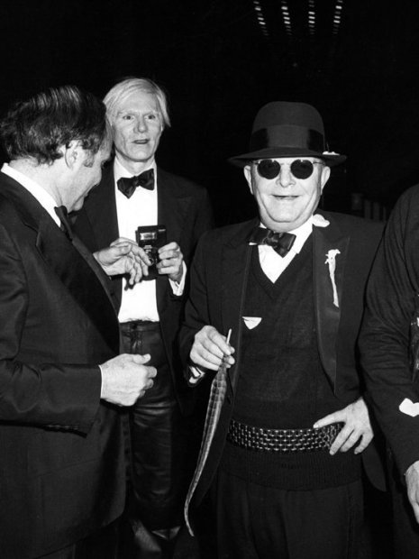 Ron Galella, Andy Warhol, Truman Capote and Lester Persky attend Steve Rubell's birthday party at Studio 54, New York, December 2, 1978