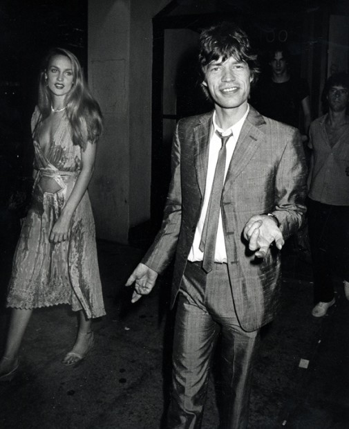 Ron Galella, Mick Jagger and Jerry Hall outside Trax after a performance by Jim Carroll, New York, June 26, 1980, 1980