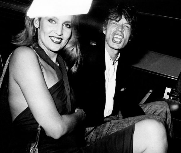 Ron Galella, Mick Jagger and Jerry Hall arrive at a party for Reid Rogers at Limelight, New York, September 19, 1974