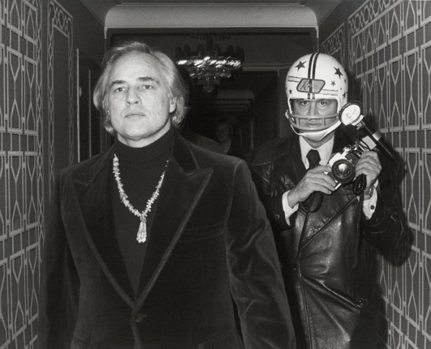 Ron Galella, Marlon Brando and Ron Galella photographed by Paul Schmulbach at the Waldorf-Astoria Hotel, New York, November 26, 1974, 1974