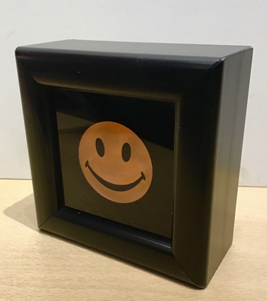 """RYCA - Ryan Callanan Mini Smiley Yellow Open Edition Poptorian Artwork signed This piece contains a small classic smiley. Some areas of the frame are slightly distressed which complements the crisp clean Smiley. Framed Size: 5"""" x5"""" x 2"""" Framed Size: 15cm x 15cm x5"""
