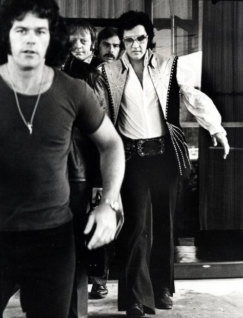 Ron Galella, Elvis and bodyguards depart the Hilton Hotel, Philadelphia, PA, June 25, 1974