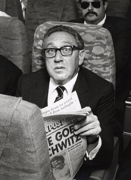 Ron Galella, Henry Kissinger aboard an Eastern Airlines shuttle flight from New York to Boston, MA, New York, June 7, 1979