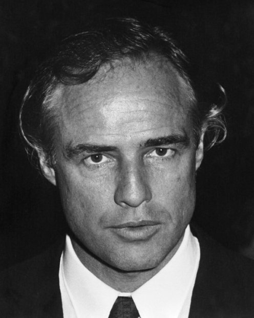 Ron Galella, Marlon Brando attends a SHARE benefit party at the Santa Monica Civic Auditorium, Santa Monica, CA, May 25, 1978