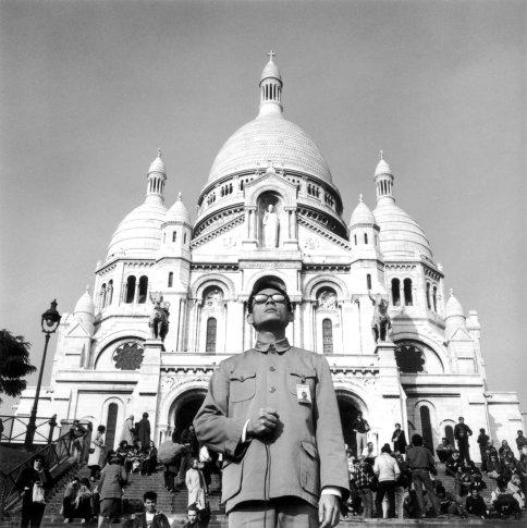 "<span class=""artist""><strong>Tseng Kwong Chi</strong></span>, <span class=""title""><em>Paris, France (Sacre Coeur)</em>, 1983</span>"