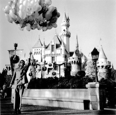 <span class=&#34;artist&#34;><strong>Tseng Kwong Chi</strong></span>, <span class=&#34;title&#34;><em>Disneyland, California (Castle and Balloons)</em>, 1979</span>