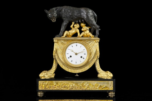 Pendulum clock in patinated and gilded bronze depicting Romolus and Remus sucking milk from a young shewolf with glass eyes, France