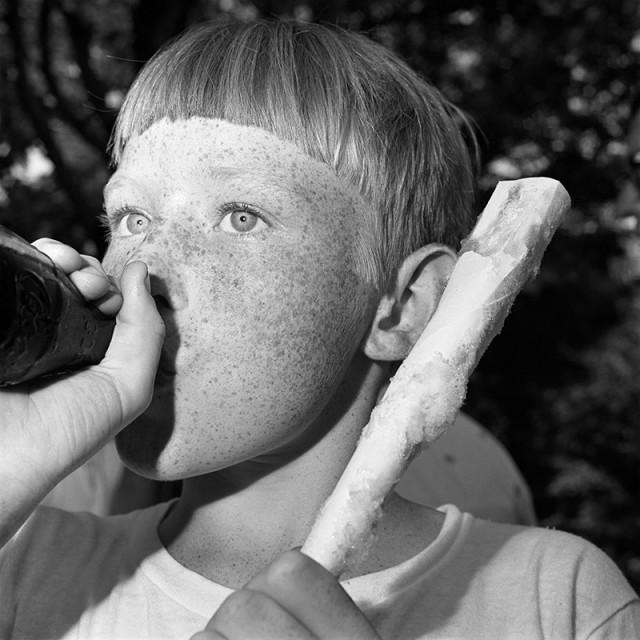 Rosalind Fox Solomon, Scottsboro, Alabama [Boy with Coke and Cotton Candy], 1976