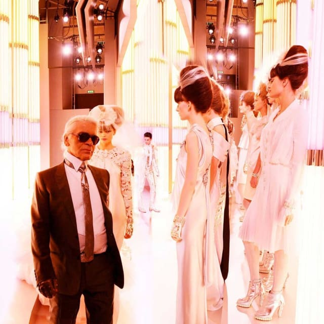 "Detail from Simon Procter's ""Chanel Karl and Brides, Haute Couture 2010, Rue Cambon, Paris"" C-print"