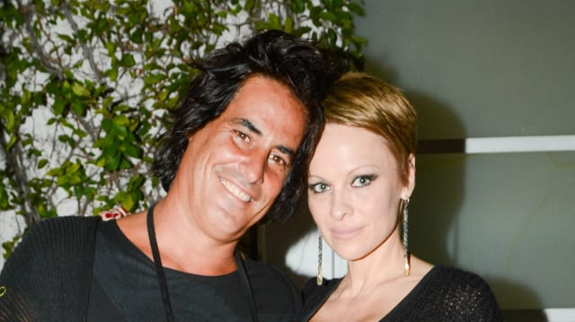 Pamela Anderson in Newly Red Pixie Cut, Wanders Through Art Basel Miami