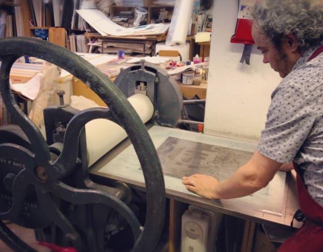 Mychael Barratt at work in his London printing studio.