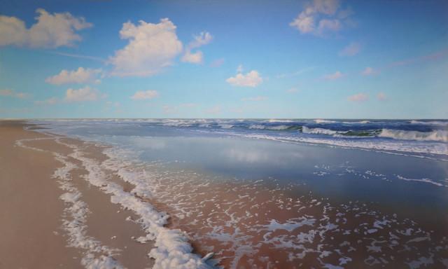 Schuim op het strand
