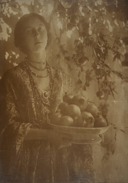 Minna Keene  Pomegranates, circa 1910  Carbon print with some details reduced by hand, flush mounted to single-ply period board, mounted to additional single-ply period board  19 ½ x 13 ⅞ inch (48.26 x 35.24 cm) print, board  25 x 19 inch (63.50 x 48.26 cm) original frame