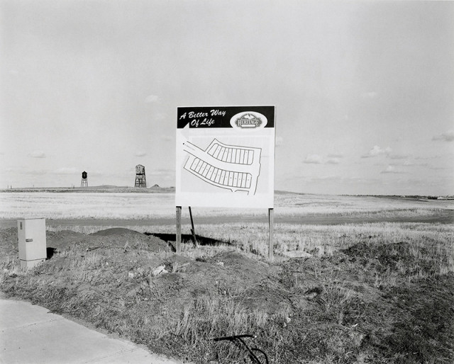 Geoffrey James  Lethbridge, A Better Way of Life, 1999  Gelatin silver print mounted to archival board  18 ¼ x 22 ¼ inch (46.36 x 56.52 cm) image  20 x 24 inch (50.80 x 60.96 cm) print  28 x 34 inch (71.12 x 86.36 cm) board  Edition of 10 (#1/10)