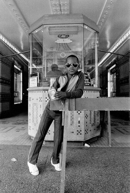 Dawoud Bey A Boy in front of the Loews 125th Street Movie Theater, 1976 Gelatin silver print 8 ⅛ x 12 inch (20.64 x 30.48 cm) image 11 x 14 inch (27.94 x 35.56 cm) paper Edition of 10 + 2 APs (#9/10)