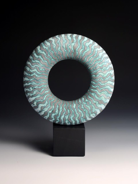 BLUE DISC ON STONE BASE