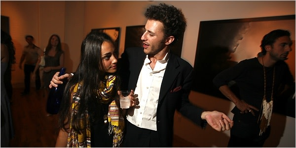 IN THE PICTURE Katie Schecter, left, with Carlo von Zeitschel at his gallery party and book signing for the photographer Paolo Pellegrin. Credit Rahav Segev for The New York Times