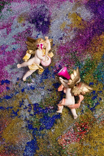"""""""La Creacion Discrimina,"""" inkjet print. Wannam's painterly use of glitter is reminiscent of fleeting sand paintings, despite appearances of an imposed, fixed narrative in the statuettes"""