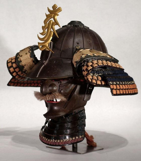 A samurai helmet and battle mask c. 1750 AD Iron, leather, copper, gilt, shakudo alloy, silk