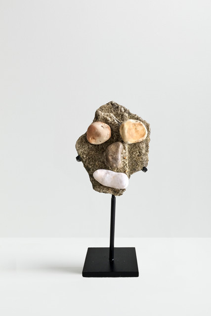 Peter Liversidge Effigy (6), 2017 Found stones, hot glue and metal stand 9 x 7 x 3 cm (excluding stand)