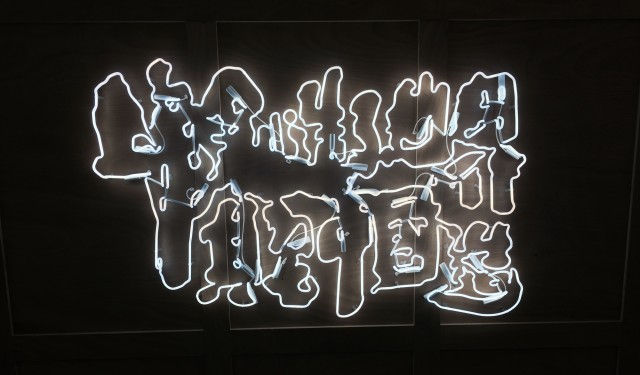 Yang Jiechang, God Created the World, The Rest is Made in China, 2015, neon calligraphy on wood crates, detail.