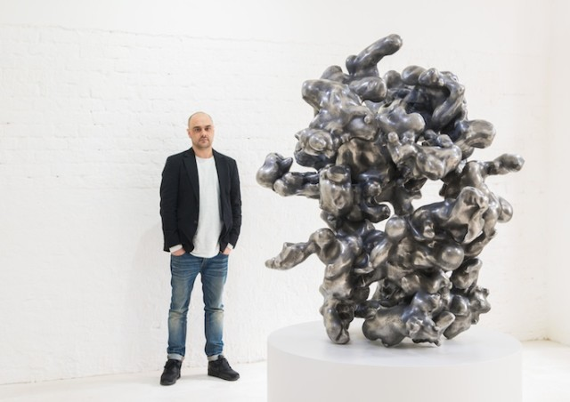 "Alex Hoda in his exhibition ""Sprachgitter"" at LISABIRD Contemporary, 2014 Sculpture: Augmund (Eyeorb), 2014, Z-Xore, Zinc, Tin, 122 x 115 x 97 cm Photo/ Copyright: Ferdinand Neumüller"