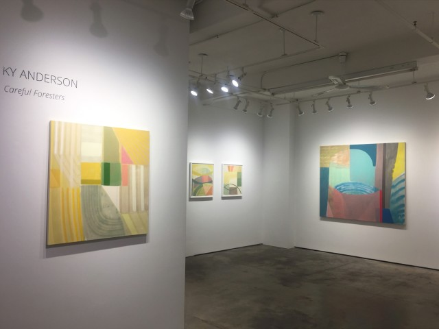 """Installation shot of four abstract paintings by Ky Anderson. The painting close by the left is under wall lettering reading, """"KY ANDERSON - Careful Foresters"""""""