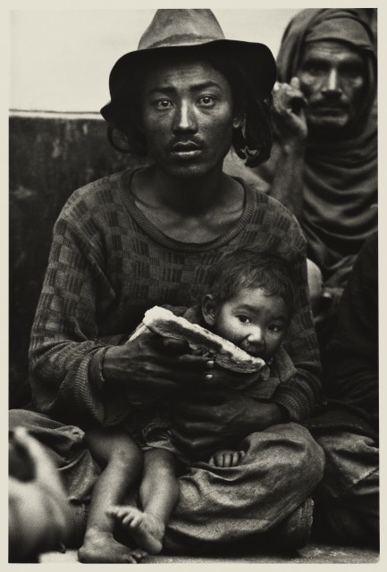 Don McCullin Strange travellers - a destitute Tibetan family in the booking hall of railway station at dawn, Delhi 1965...