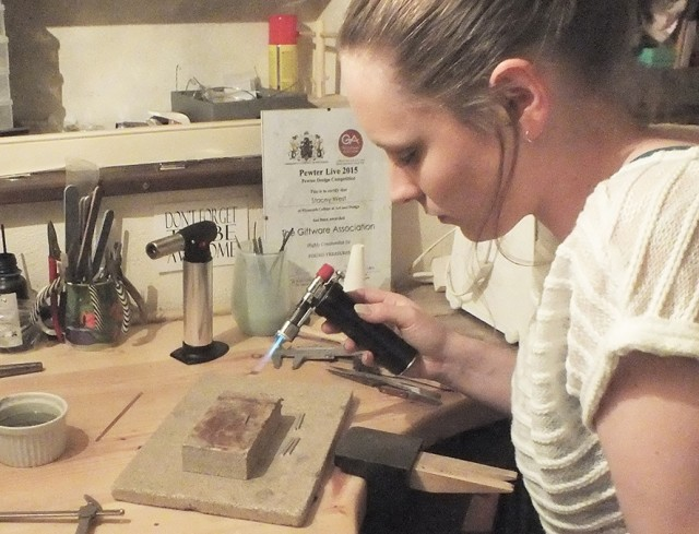 Stacey West at work in her studio