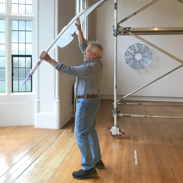 Neil Dawson installing Feather (Gull), March 2019, The Central Art Gallery