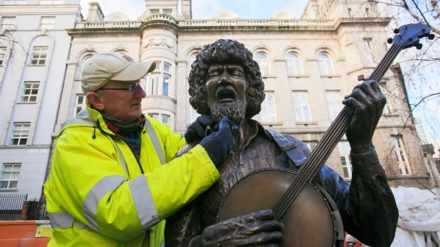 John Coll puts the finishing touches to the sculpture on King Street
