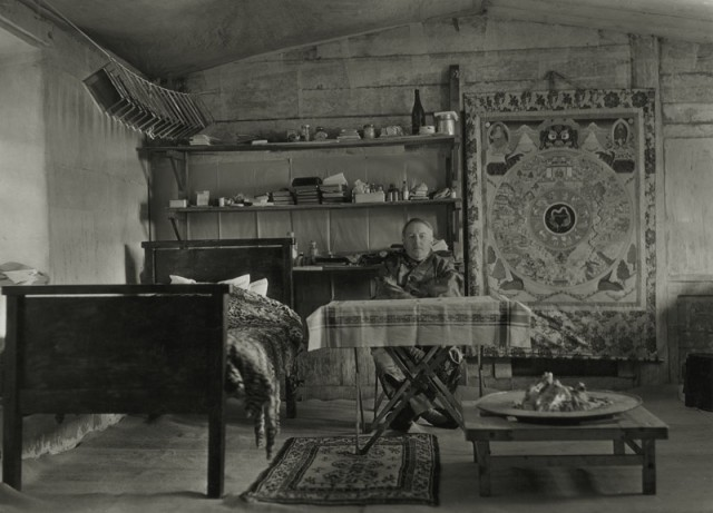 Joseph F. Rock 1884-1962 Joseph Rock at home, photographic plates drying above his bed, Nguluko, China, circa 1928 Press caption, with annotations and stamps, in ink, au mount verso Printed circa 1928 Gelatin silver print mounted to 6 3/4 x 9 inch (17.15 x 22.86 cm) period board 5 1/2 x 7 3/4 in 13.97 x 19.69 cm