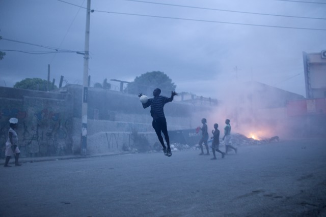 Benoit Aquin b. 1963 L'envolée, Port-au-Prince, Haïti, 2010 Signed, titled, dated and editioned, in pencil, au mount verso Printed in 2012 Pigment print on 26 x 36 inch (66.04 x 91.44 cm) archival paper flush-mounted to archival board 20 x 30 in 50.8 x 76.2 cm Edition of 2 (#1/2)