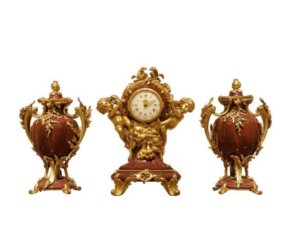 A three-piece clock garniture