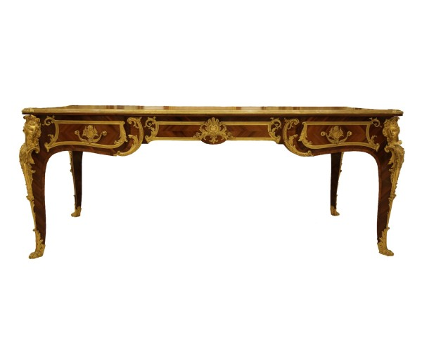 A gilt bronze mounted tulipwood and kingwood desk, after a model by Charles Cressent