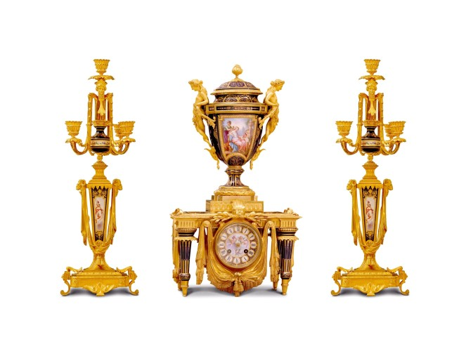 A French ormolu-mounted Sèvres style porcelain cobalt-blue ground three-piece clock garniture